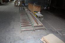 Roller conveyor belts and sides