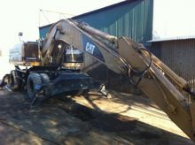 1998 Caterpillar M318 Wheeled e