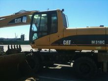 2004 Caterpillar M318C Wheeled