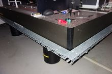 Optical clamping table for lase