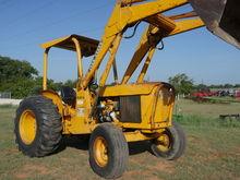 1975 John Deere 302 Tractors