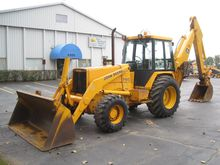 1989 DEERE 710C Backhoe loader
