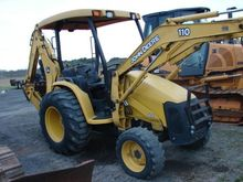 2009 DEERE 110 Backhoe loader