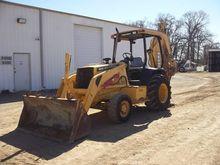 2000 DEERE 310E Backhoe loader
