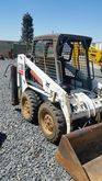 2005 BOBCAT S130 and A709 Backh