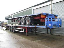 2004 SDC Tri-axle flat trailer