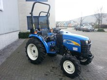 Used Holland T1560 4