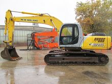 Used Holland E215 in