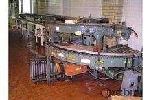 Case packer discharge conveyor