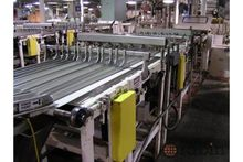 Wrapper infeed alignment convey