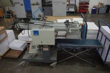 Envelope feeder with outlay