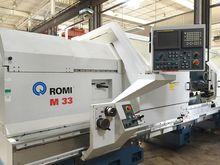 "2006 24"" chuck Romi Model M-33"