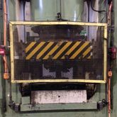 Hydraulic press to coin Etchell