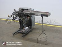 Thiele Feeder Coupon Inserter T