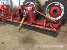 rotary harrow with open cage ro