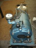 Vacuum pump with bell jarr for