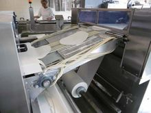 Laminating system for pizza dou
