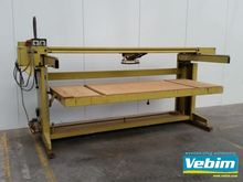 Belt sander with sliding table