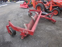 Harmon 310 3pt stone windrower