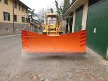 Loader with snowplow blade