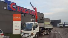 Isuzu Q75.4 cranes and tipper T