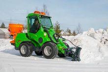 Skid multifunction avant snowpl