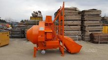 Concrete mixer with reversing g