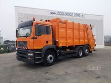 MAN TGA 26.310 with waste compa