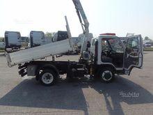 Isuzu nkr 55 l midi dump truck
