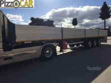 Semitrailer truck with coils ho
