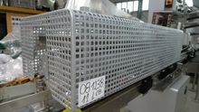 Capsule shrink wrapping machine