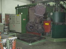 PRESSING AND ROTATION SYSTEM
