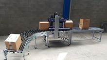 PACKING LINE WITH TAPING