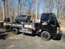 2005 Isuzu Cabover with 300 Gal