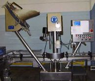 Closing machine for glass jars