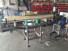 Conveyor belt with adhesive lab