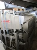 Upmann weigher and tray packing