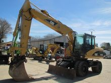 2003 CAT M 315 C Wheel excavato