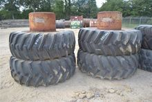 LOT OF DUAL TRACTOR TIRES . ~