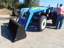 HOLLAND TT60A W/ 620 LOADER / H