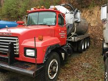 1997 red Mack tri-axle water tr
