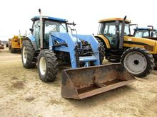 HOLLAND TS115A TRACTOR W/WOODS