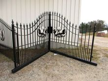METAL GATES WITH WILDLIFE ENGRA
