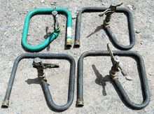 Grouping of Four Lawn Sprinkler