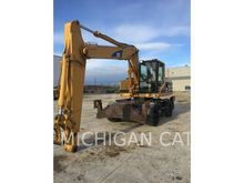 2000 Caterpillar M318 Wheeled e