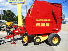 New Holland 688 round baler wit