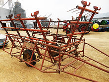 Melroe 27' coil-tine harrow on