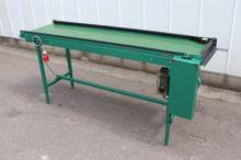 Schoemans conveyor -packing tab