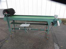 Schoemans conveyor packing tabl