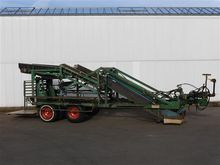 Sam bed lifter harvesting machi